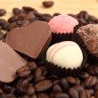 Chocolate heart-shaped candies and cake - Stock Photo