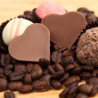 Chocolate heart-shaped candies and cake — Foto de Stock