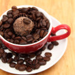 Cup with coffee beans and chocolate cake - Stock Photo