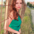 Girl in a green dress on the street — Stockfoto