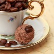 Coffee beans in cup and saucer — Stok fotoğraf
