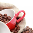 Coffee beans in ceramic coffee cup — Stock Photo
