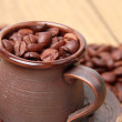 Delicious dark brown coffee beans in ceramic coffee cup — Foto Stock