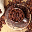 Coffee beans with ceramic cup — Stock Photo