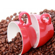 Coffee beans in red cup with heart symbol — Stock Photo #23834039
