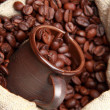 ストック写真: Roasted coffee beans with ceramic coffee cup over burlap coffee bag