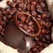Stock Photo: Roasted coffee beans with ceramic coffee cup over burlap coffee bag