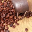 Stock Photo: Delicious dark brown coffee beans in small ceramic cup