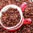 Top view on coffee beans in red cup — Stock Photo