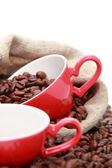 Coffee beans in ceramic red coffee cup — Stock Photo