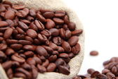 Coffee beans and sack — Stock Photo