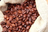 Coffee beans and sack — Foto de Stock