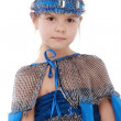 Expressive little girl dressed in a blue costume and dance - Stock Photo