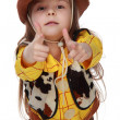 Beautiful little girl in a cowboy costume on white background - Stock Photo