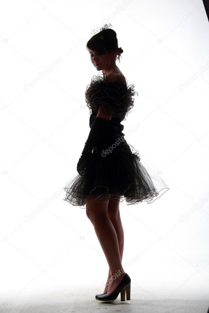 Silhouette of beautiful girl in dress — Stock Photo ...