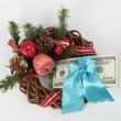 Stack of hundred-dollar bills and Christmas decorations - Stock Photo