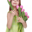 Happy little girl with a big bouquet of tulips - Stockfoto