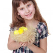 Cute little girl holding a decorative basket with Easter baby chicken — Stock Photo