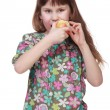Little girl in colorful clothes eating an apple — Stock Photo