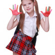 Happy little girl with paints on hands - Stock Photo