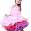 Little girl in a pink dress dancing isolated on a white background — Stock Photo #24700623