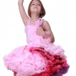 Little girl in a pink dress dancing isolated on a white background — Stock Photo #24700853