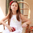 Stock Photo: Girl in rocking chair