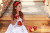 Girls with apples on the stairs — Stock Photo