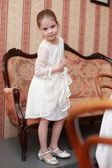 Lovely little girl in a beautiful dress — Стоковое фото