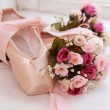 Pair of dainty pink ballet shoes — Stock Photo