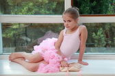 Beautiful young dancer in a pink leotard has been training in ballet class — Stock Photo