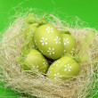 Image of green egg with pattern in Easter basket — Stock Photo #26930357