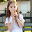 White ice cream in hand of beautiful little girl — Stock Photo #26948097