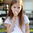 White ice cream in hand of beautiful little girl — Stock Photo #26948457
