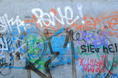 A Wall with lots of Graffiti — Stock Photo