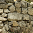 Old stone wall collapses — Stock Photo