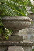 Old stone vase stands on the railing of the stairs — Stock Photo