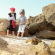 Stock Photo: European children smiling boy and girl in fancy dress pirate looking for buried treasure