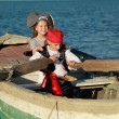 Caucasijoyful little children playing pirates on sea — Stock Photo #29237123