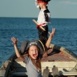 Caucasian joyful little children playing pirates on the sea — Stock Photo