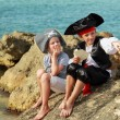 Beautiful young kids pirate boy and girl holding a pirate map — Stock Photo