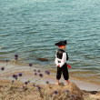 Happy young boy wearing a pirate costume outdoors — Stock Photo