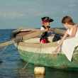 Children play in a pirate of the sea — Stock Photo