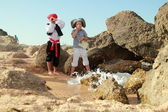 Caucasian boy and girl pirate corsair pirate holding the map in search of treasure — Stock Photo