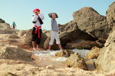 Adorable young boy and girl pirates currently hold the map to find the treasure — Stock Photo
