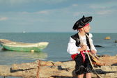 Young pirate prepares to sail on a boat in the open sea on marine recreation — Stock Photo