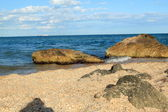 Sea landscape with big stones in the sea and on the shore on a sunny summer day — Stock Photo