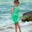 Little Greek goddess on the beach. — Stock Photo