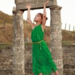Beautiful little Greek goddess in emerald green dress. — Stock Photo