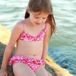 Little cute girl on beach — Stock Photo